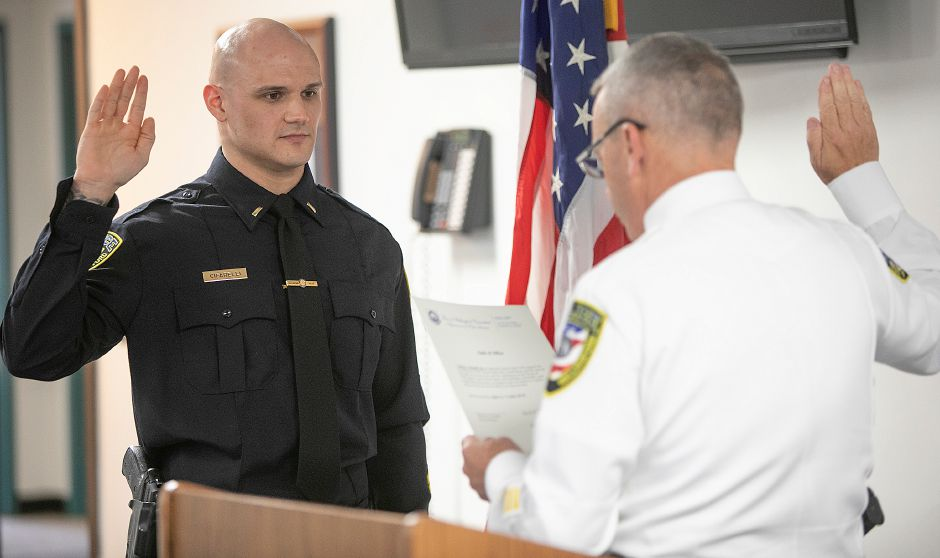 Sgt. James Cifarelli, left, is sworn-in as lieutenant by Chief William Wright during a badge-pinning ceremony at the Wallingford Police Dept., Mon., Apr. 29, 2019. Dave Zajac, Record-Journa