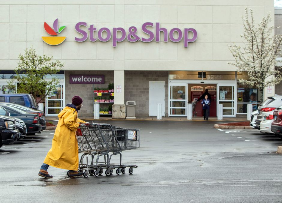 A Stop & Shop employee works on gathering shopping carts at the Meriden store on Centennial Avenue. Aaron Flaum, Record-Journal