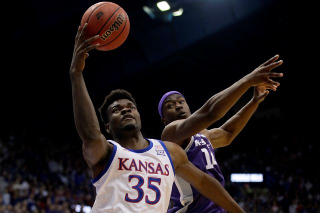 Kansas center Udoka Azubuike (35) rebounds against Kansas State forward Makol Mawien (14) during the first half of an NCAA college basketball game in Lawrence, Kan., Tuesday, Jan. 21, 2020. (AP Photo/Orlin Wagner)