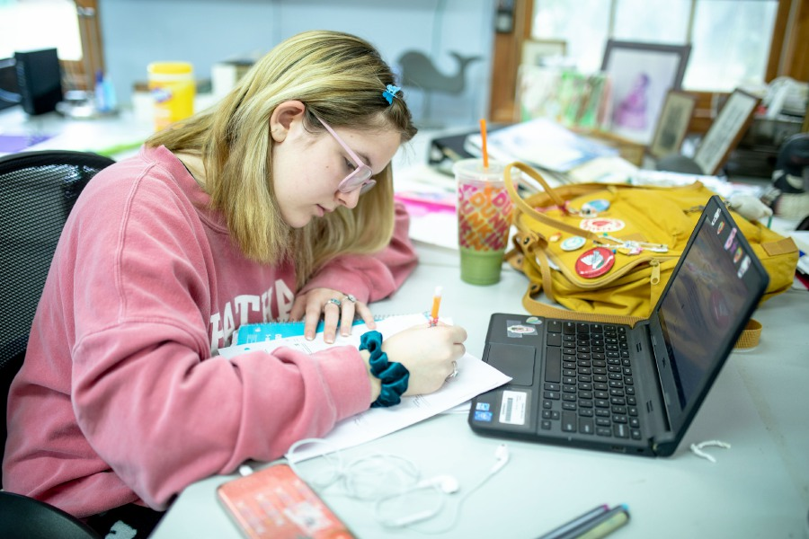 Cheshire High School senior Emma Cody, 17, at work on her third day of online instruction on March 20, 2020. Schools across Connecticut remain closed until March 31 to contain the spread of coronavirus. | Devin Leith-Yessian