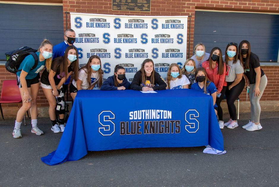 Shannon Litchfield was joined by her Southington soccer teammates when she signed her National Letter of Intent with the University of Albany on Thursday on Dom's Way outside of Southington High School. Litchfield and the Lady Knights went 14-0-0 in the abbreviated fall season of 2020 and captured the CCC Region B championship. Aaron Flaum, Record-Journal
