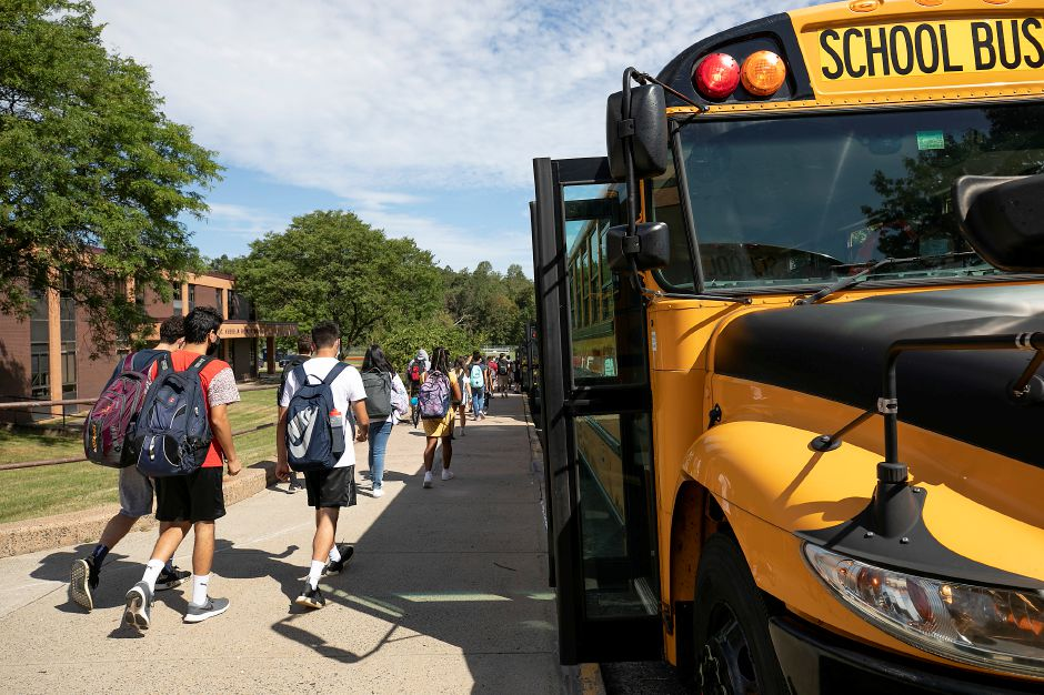 Sheehan High School students head to their buses at dismissal on the first day of school in Wallingford Sept. 3. Dave Zajac, Record-Journal