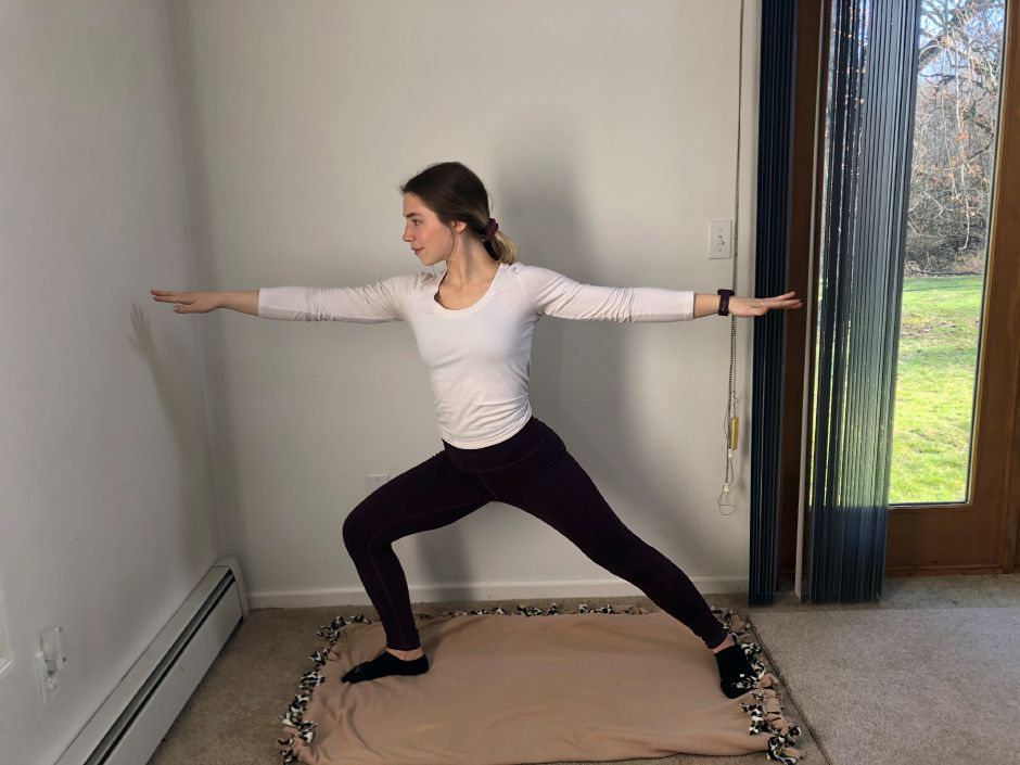 Dearborn demonstrates a vinyasa flow yoga.