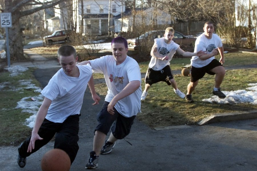 (L-R) Ian Shields, Matt Lucas and Richard Morow, and Marc Santagata, all 16 years old, play a game of pick-up basketball Monday afternoon on Converse Street in Meriden Feb, 26, 2001