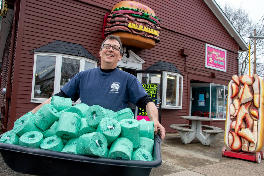 Vinny Iannuzzi,  owner of Vinny's Deli on Center Street in Wallingford, holds toilet paper he has at his deli on Thursday. He is giving away a roll of toilet paper with every sandwich when you show  the coupon from the deli's social media pages. Aaron Flaum, Record-Journal