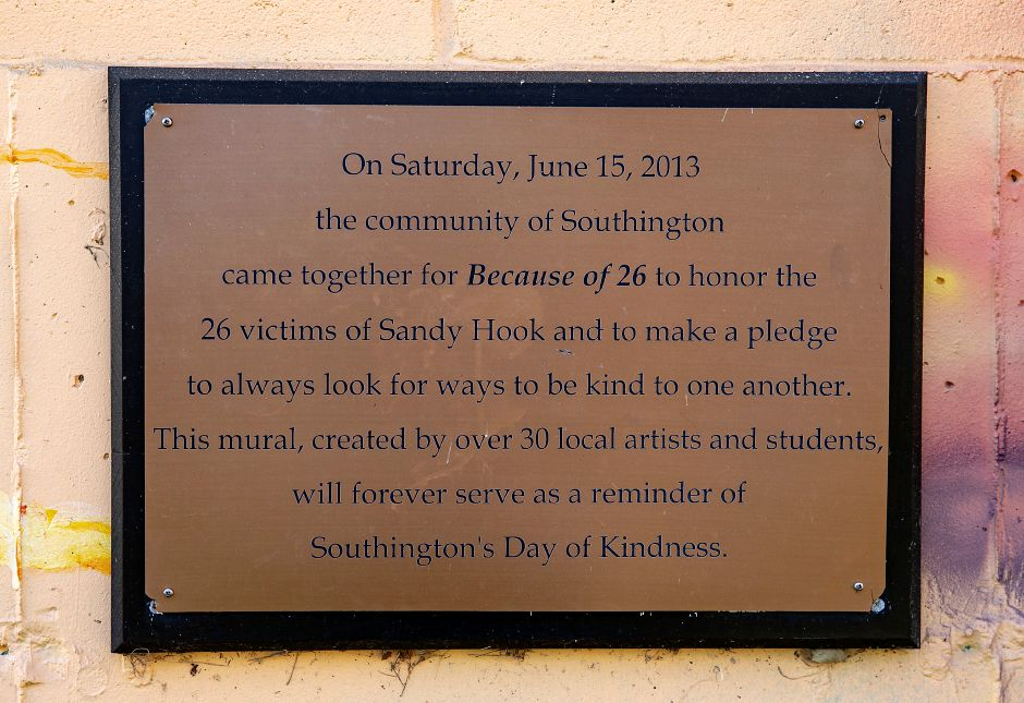 A plaque commemorating a mural dedicated to the 26 victims of the Sandy Hook shootings along the Farmington Canal Heritage Trail in Southington, Mon., Dec. 7, 2020. 30 local artists and students created the mural dedicated June 15, 2013. Dave Zajac, Record-Journal