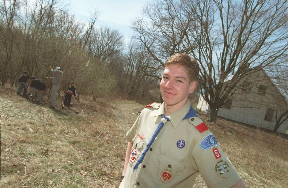 With the help of other scouts, scout leaders and friends, Kiernan Schmitt, 15 of Wallingford is sprucing up the grounds around the Blakeslee House with to earn his Eagle Scout badge April 3, 2000. He is a Boy Scout with Troop 5 at the First Congregational Church.