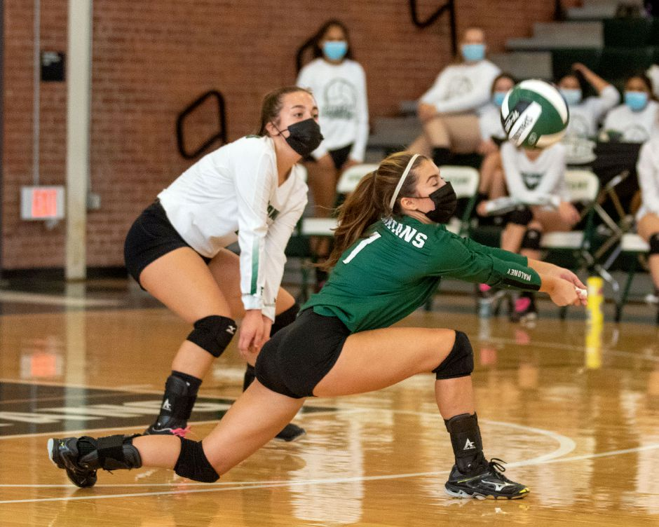 Kelsey Drost had 20 digs and served her team out of a 21-15 deficit in Game 3 during Monday's 3-1 road victory over Newington, a CCC thriller capped by a 34-32 Maloney win in Game 4. Aaron Flaum, Record-Journal