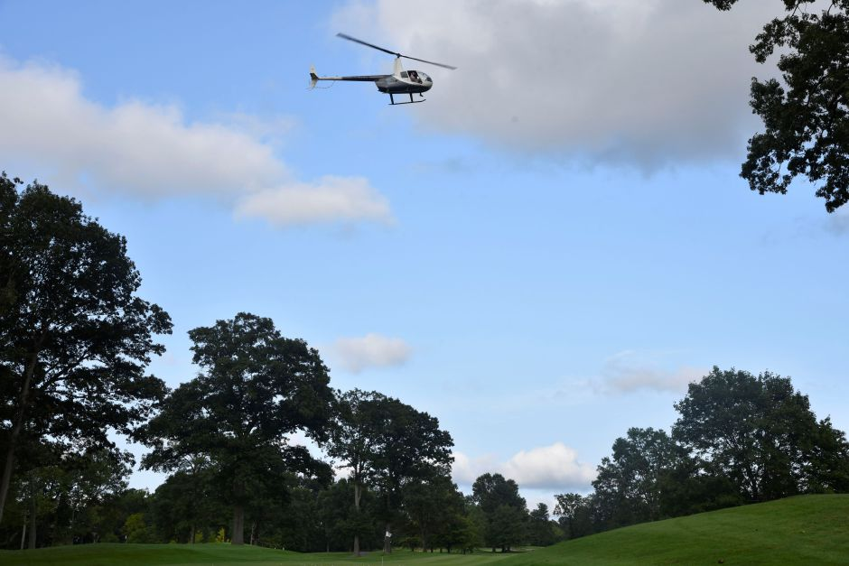 An AirOcean Aviation helicopter drops dozens of golf balls from about 50 feet in the air onto The Farms Country Club fairway in Wallingford on Tuesday, August 21, 2018, as part of 34th annual Golf Classic at the Farms. Proceeds from the raffle will be donated to the Quinnipiac Business Education Foundation. | Bailey Wright, Record-Journal