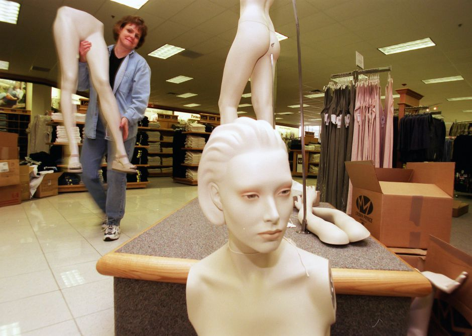 Visual specialist Jackie Morgan of Madison, Wisconsin, assembles and dresses a mannaquin in the womans clothing department of new Kohl