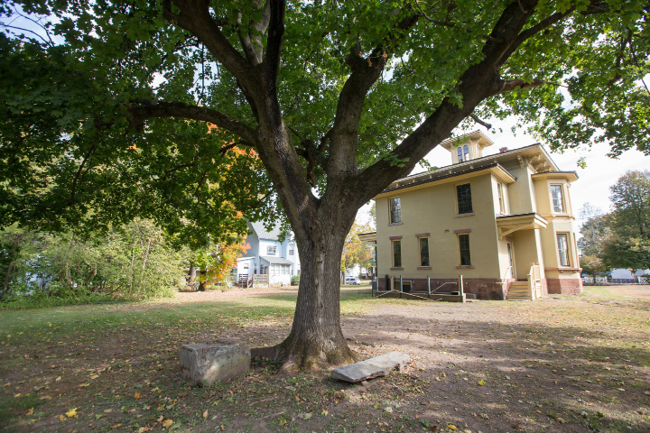 Gravestones under a tree in the back of the Johnson Mansion were used as carriage stepping stones Wednesday in Wallingford Oct. 21, 2015 | Justin Weekes / For the Record-Journal