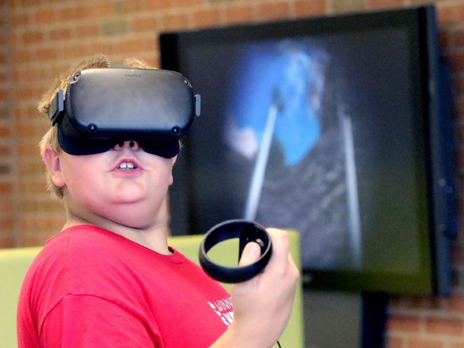 Atreyu Jordan 12 of Meriden, reacts to his Virtual Reality roller coaster ride during a Virtual Reality Experience for Teens class at the Collaboratory at the Wallingford Public Library on Tuesday August 13, 2019. Aaron Flaum, Record-Journal Staff