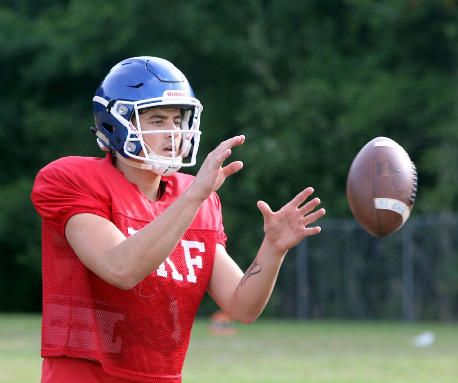 Newly minted quarterback Brady Lafferty and the Southington Blue Knights open the 2019 season on Friday in West Hartford against Conard. | Aaron Flaum, Record-Journal