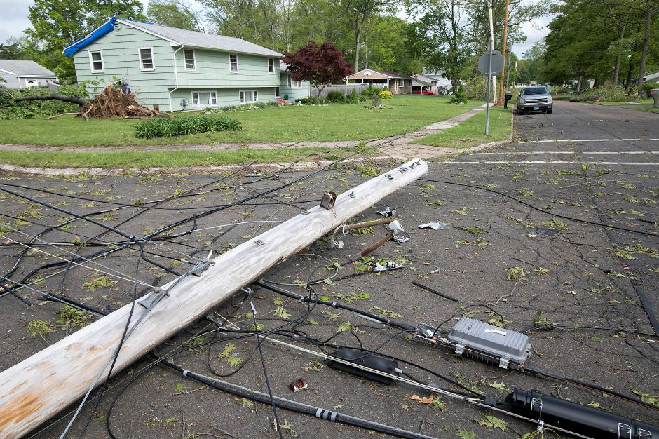 A downed utility pole at the intersection of Balsam Road and Blakeslee Road in Wallingford, Thursday, May 17, 2018. The area was hit hard by Tuesday