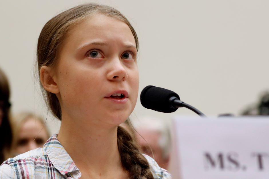 Youth climate change activist Greta Thunberg, left, speaks at a House Foreign Affairs Committee subcommittee hearing on climate change Wednesday, Sept. 18, 2019, on Capitol Hill in Washington. (AP Photo/Jacquelyn Martin)