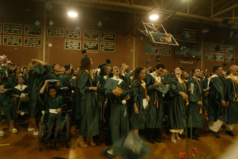 The class of 2002 at Francis T. Maloney High School throw their mortar boards in the air to signify the end of graduation ceremonies at Platt on Friday evening June 14, 2002.