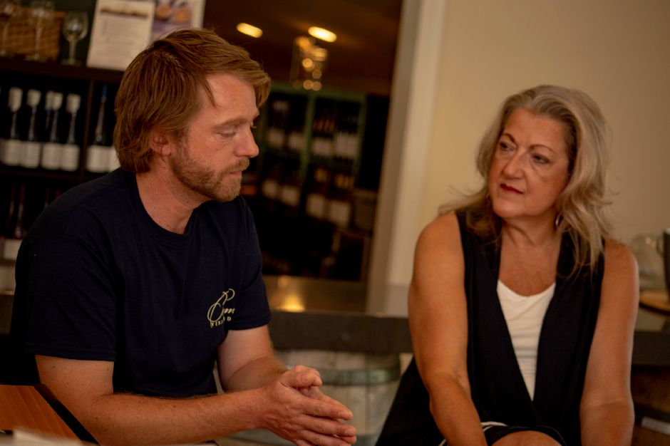 Wine maker Ruuan Viljoen discusses the wine-making process as Priam Vineyards founder and co-owner Gloria Priam looks on Aug. 16, 2018. | Richie Rathsack, Record-Journal