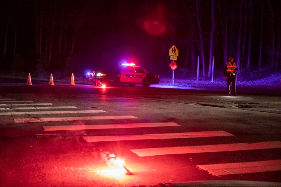 A Meriden police officer blocks traffic on Oregon Road in Meriden Thursday April 11, 2019 after a plane crashed at Wilcox Technical High School. | Devin Leith-Yessian, Record-Journal