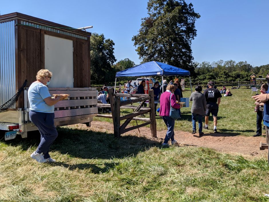 Attendees grab food and make their way onto the field at Hickory Hill Orchards during Family Fun Fest, an inaugural event that benefited the Hope Pregnancy Center in Cheshire.