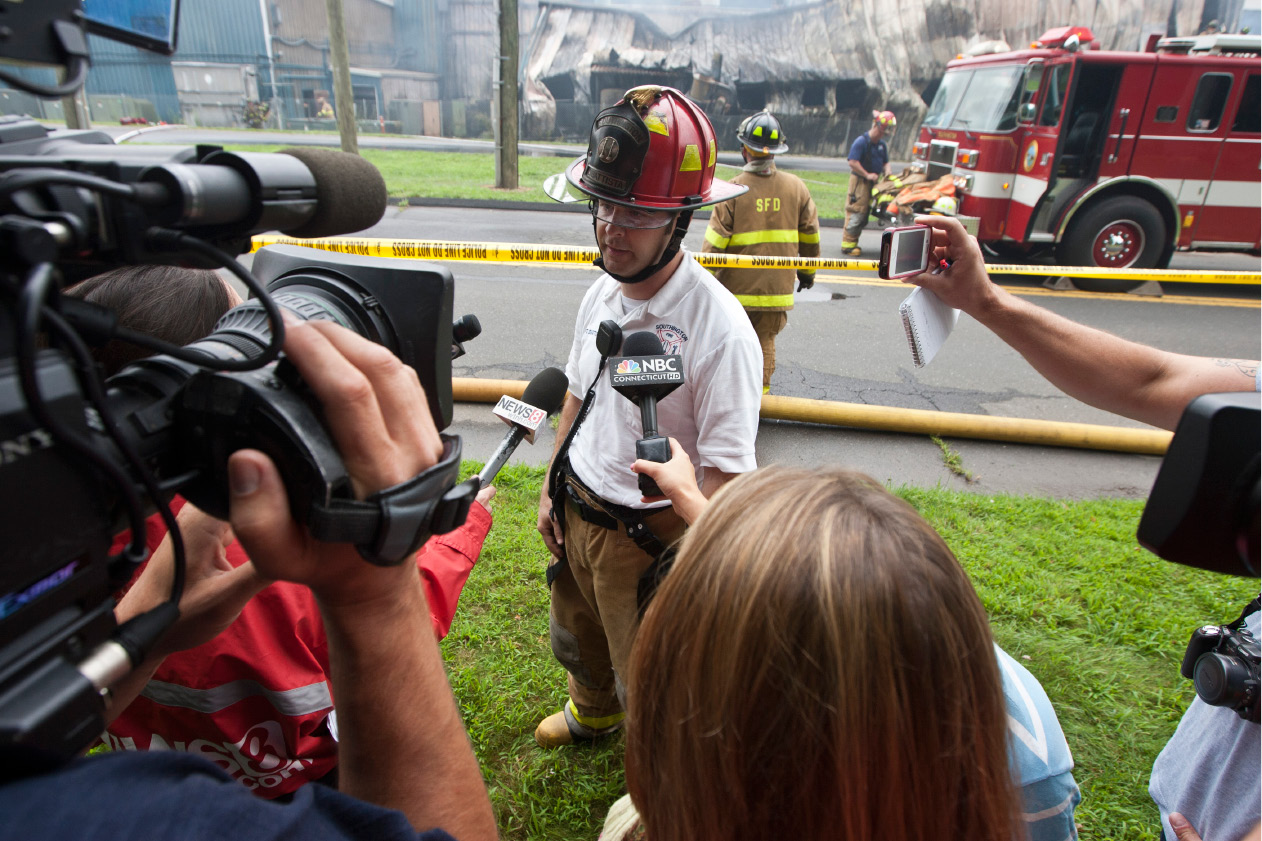 FILE PHOTO: Capt. Scott DiBattista briefs the media about the fire fighting operations at the Rex Forge manufacturing plant on Atwater Street in Southington, Tuesday morning, July 31, 2012. DiBattista said the upon the the fire department