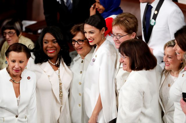 Democratic members of Congress, including Rep. Alexandria Ocasio-Cortez, D-N.Y., center, pose for a photo before President Donald Trump delivers his State of the Union address to a joint session of Congress on Capitol Hill in Washington, Tuesday, Feb. 5, 2019. (AP Photo/J. Scott Applewhite)