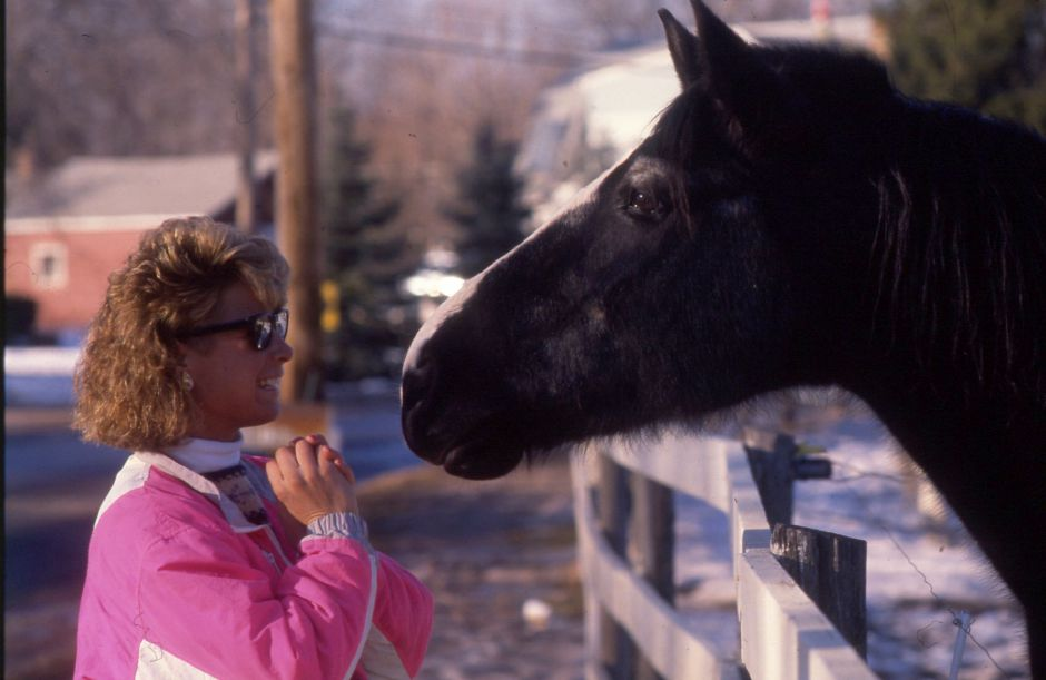 RJ file photo - Karen Shatas of Southington spends some of her college vacation visiting a horse named Ebony at the Belly Acres Ranch in Cheshire, Jan. 1990.