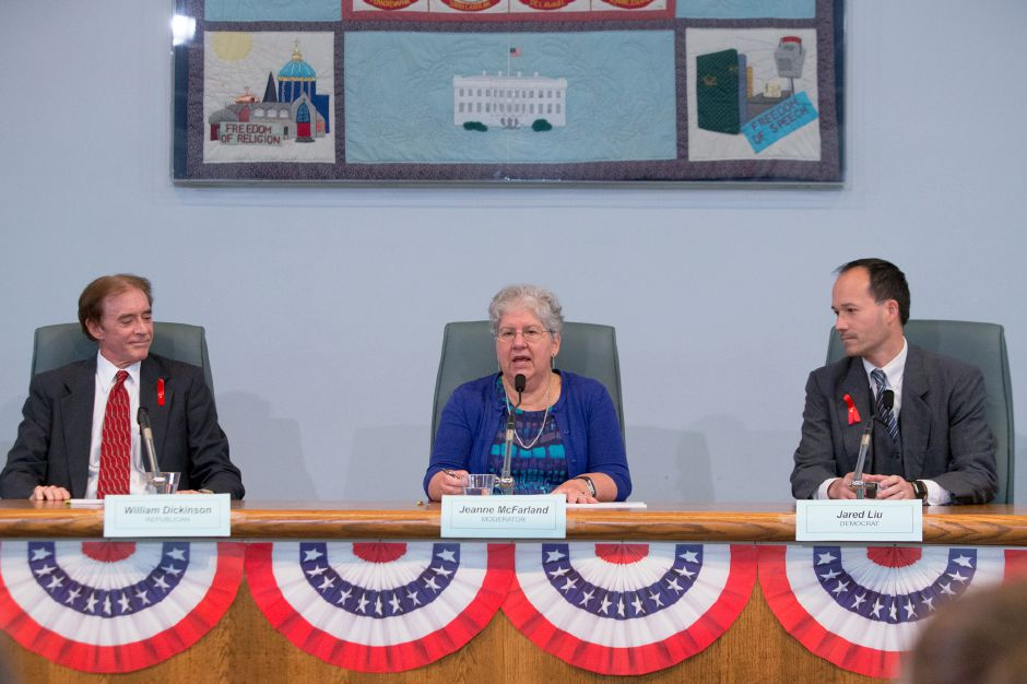 Moderator Jeanne McFarland welcomes Mayor William Dickinson Jr. (R) left and Jared Liu (D) Thursday during a candidate forum at the Wallingford Town Hall in Wallingford October 26, 2017 | Justin Weekes / For the Record-Journal