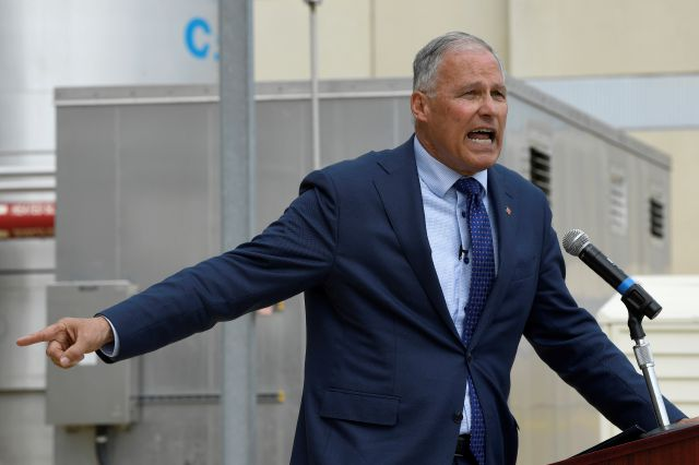 Democratic Presidential candidate Washington Gov. Jay Inslee speaks during an event at the Blue Plains Advanced Wastewater Treatment Plant in Washington, Thursday, May 16, 2019, during an event where he unveiled part of his plan to defeat climate change. (AP Photo/Susan Walsh)