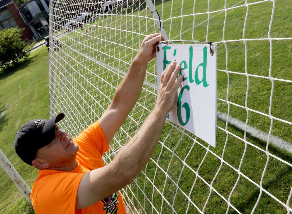 Sean Stowik of Wallingford puts a sign up at Choate Rosemary Hall in preparation for the 2019 TWIST soccer tournament. While the coronavirus crisis has altered planning meetings, the Wallingford Youth Soccer League at this point remains on course to stage the 2020 event during its usual mid-August time slot. Aaron Flaum, Record-Journal Staff