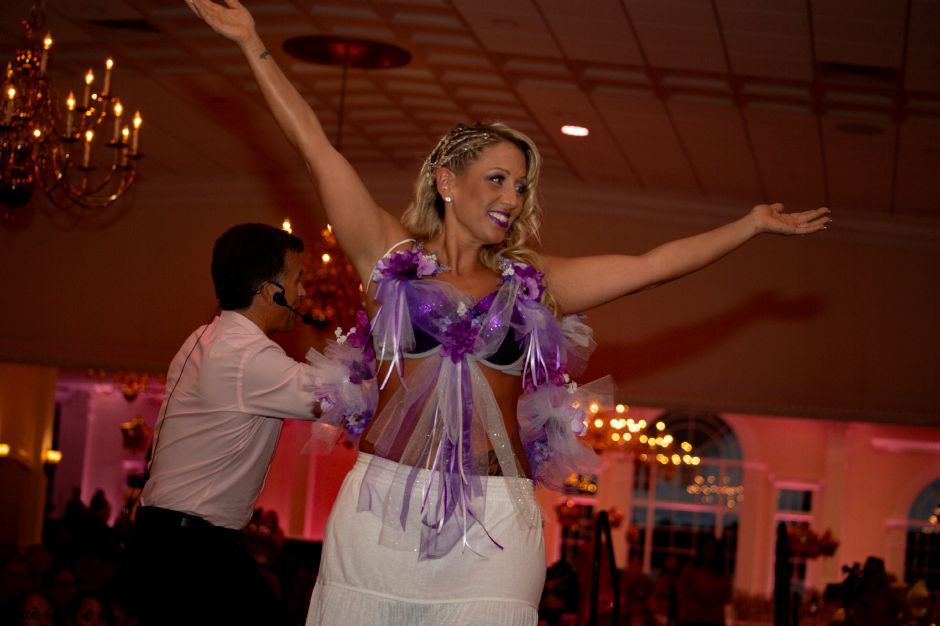 "Kim Tyseck shows off ""Purple Haze"" as auctioneer Tom Gagliardi calls out bids during the Art Bra 2018 Runway Show and Auction Aug. 9, 2018 at the Aqua Turf in Southington. 
