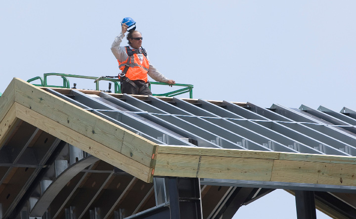 A construction worker briefly removes his helmet while working on the roof of the Wallingford train station in high temperatures, Wednesday afternoon, July 6, 2016.  | Dave Zajac, Record-Journal