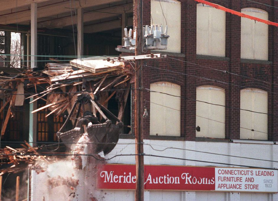 RJ file photo - The Meriden Auction Rooms building, as East Main Street fixture in Meriden for 35 years, came down March 23, 1999.