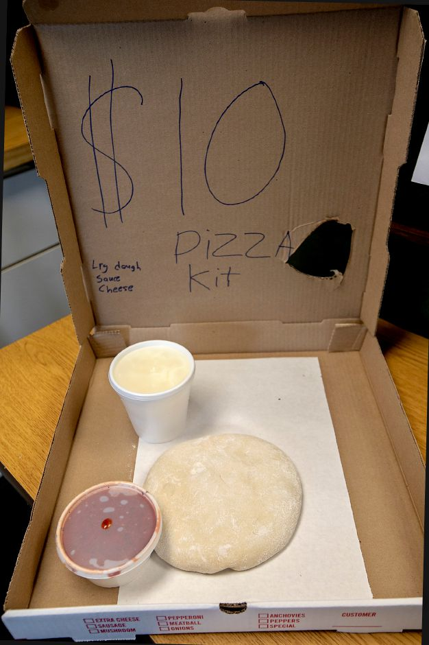 A pizza kit available at Bella Luna Pizza & Restaurant on Liberty Street in Meriden, Fri., May 1, 2020. The kits are $10 for one large dough with cheese and sauce. Additional toppings are extra. Dave Zajac, Record-Journal