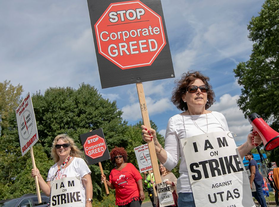 Toni DeStefano, of Waterbury, right, and other employees of UTC Aerospace Systems, walk the picket line during a strike in front of the business on Knotter Drive in Cheshire, Monday, Sept. 17, 2018. Dave Zajac, Record-Journal