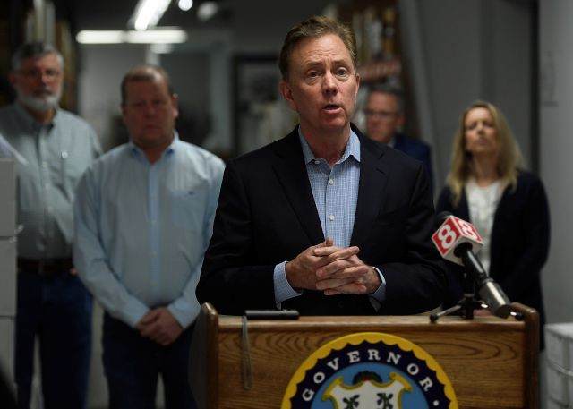 Connecticut Gov. Ned Lamont addresses the media at medical equipment manufacturer Bio-Med Devices in Guilford, Conn. on Sunday, March 29, 2020. The company has signed a contract to produce ventilators for the state at an initial quantity of ten per week for ten weeks. (Brian A. Pounds/Hearst Connecticut Media via AP)