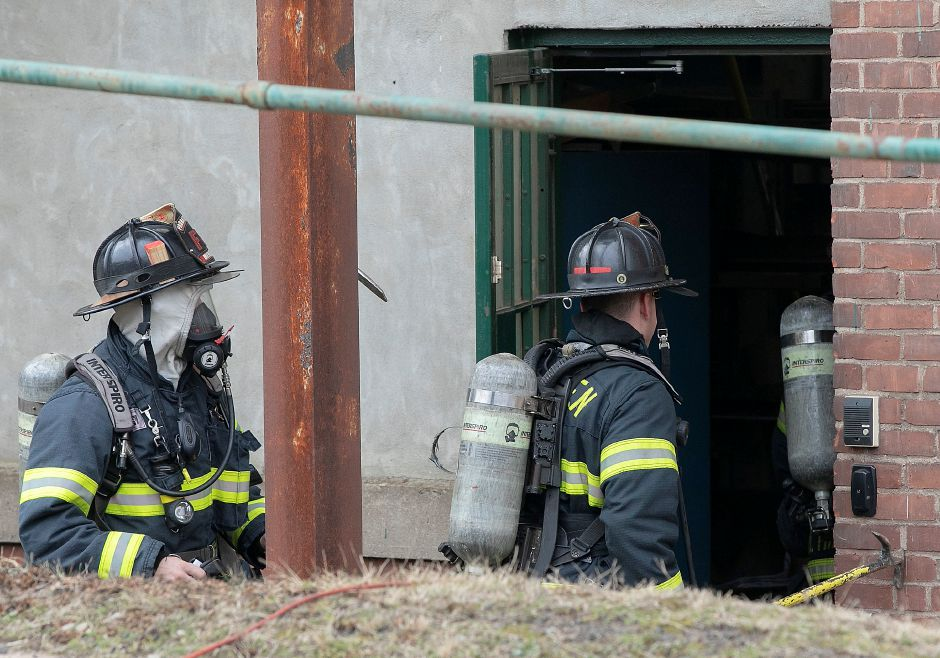 Meriden firefighters enter the basement at 290 Pratt St. in Meriden, Wed., Feb. 5, 2020. A machine fire in the basement of the Meriden Enterprise Center Wednesday morning forced the evacuation of the large former factory building. Dave Zajac, Record-Journal