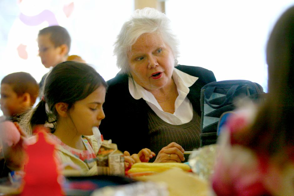 Derynoski School Principal, Karen Smith sits with students at lunch in 2010.  Record-Journal file photo