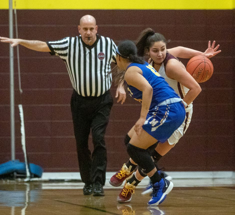 Sheehan's Caitlyn Velez dribbles the ball behind her back to get past Mercy's Jasmine Mendez during the first half at Sheehan High School on Friday, February 14, 2020. Aaron Flaum, Record-Journal