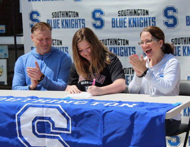 Southington swimmer Hannah Lasbury finalizes her commitment to Eastern Connecticut State University flanked by her parents, Bob and Amy Lasbury. | Photo courtesy of Stefanie Melanson