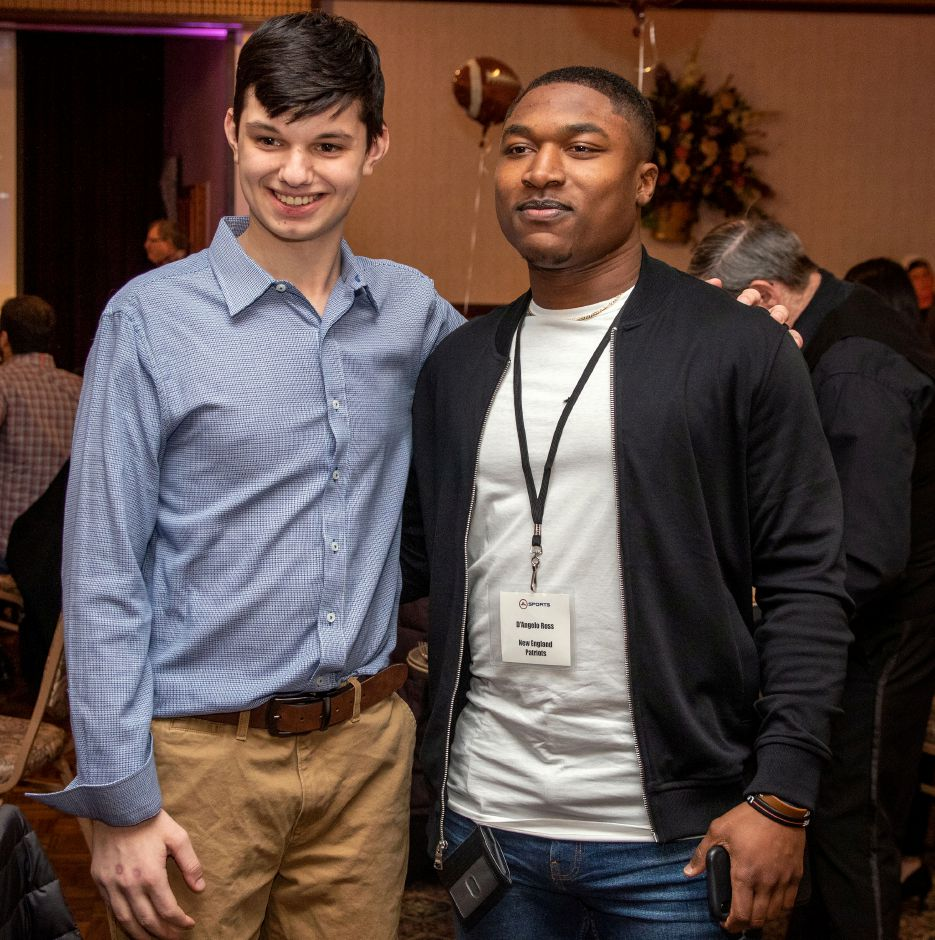 Landon Rocchio 15, of Orange, gets a photo with New England Patriots D'Angelo Ross during the 27th Annual United Way 2020 NFL Players Weekend NFL Players Live Auction and Dinner Buffet at the Zandri's Stillwood Inn in Wallingford onFriday, March 6, 2020. Aaron Flaum, Record-Journal