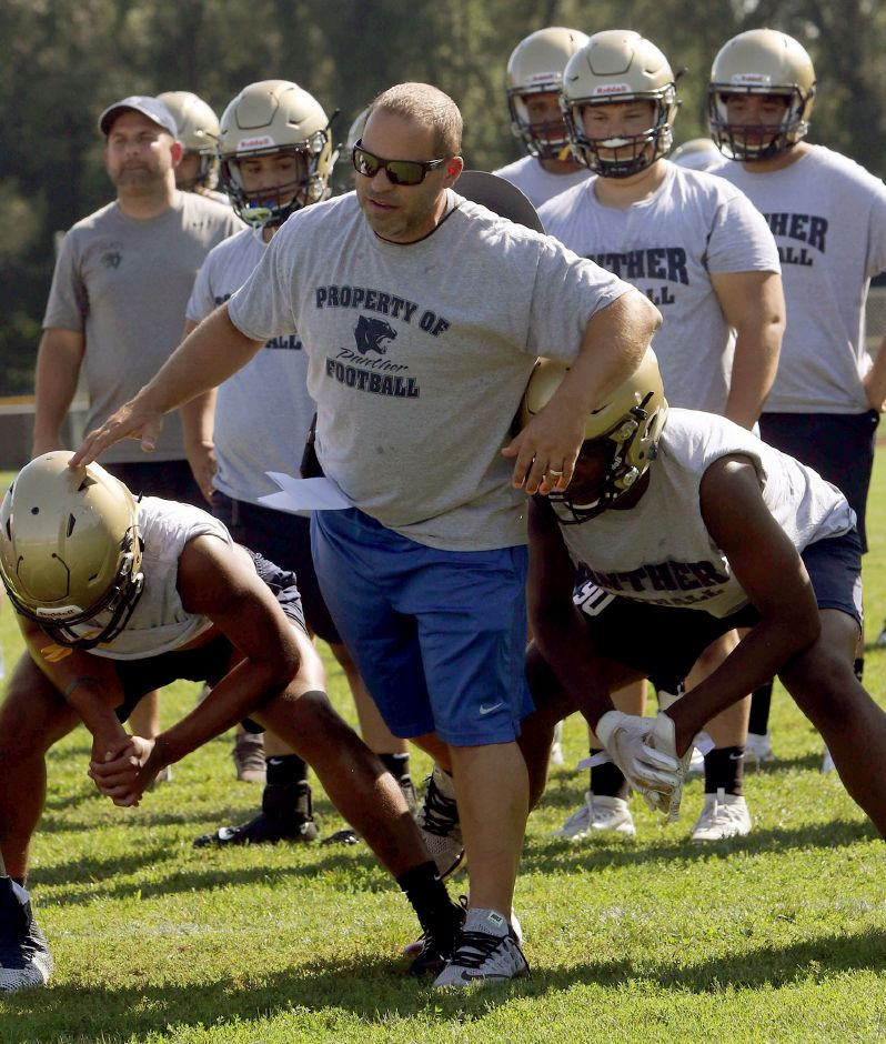 Platt head football coach Jason Bruenn works with his players on Tuesday August 20, 2019 during the first week of practice. Aaron Flaum, Record-Journal Staff