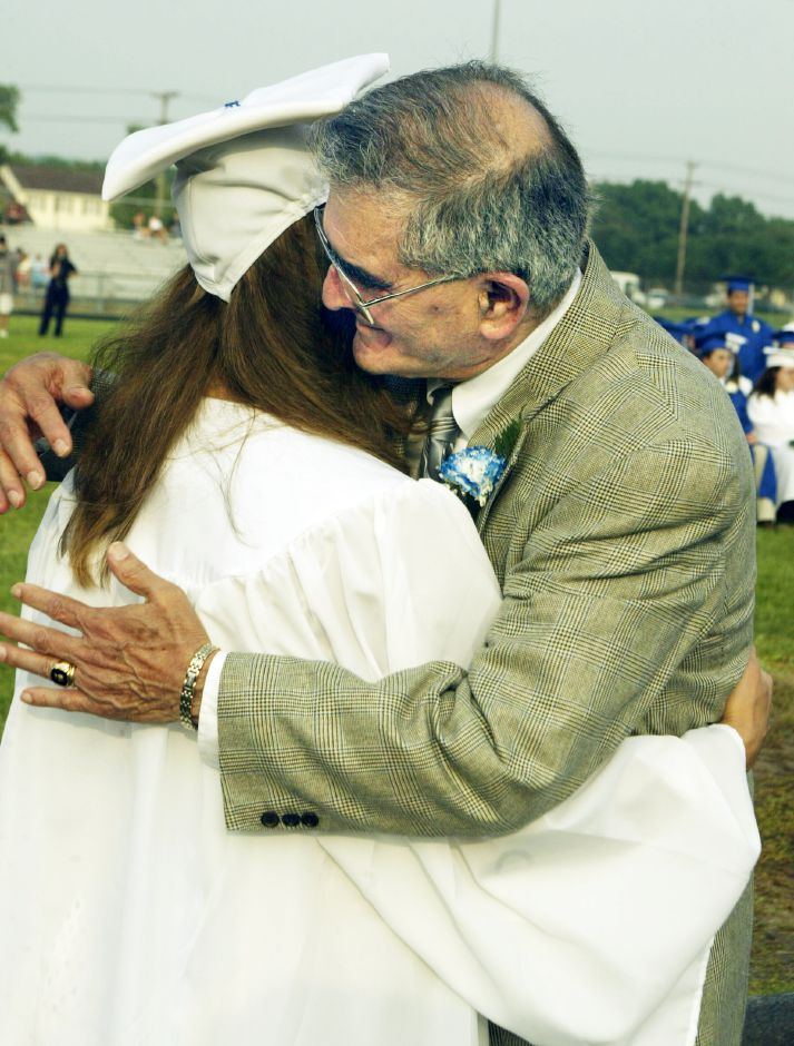 Sut. Board of Ed. member Zaya Oshana gives a big hug to his granddaughter Mallory Angelica Oshana Caloutas after he presented her with her diploma during graduation ceremonies Fri. June 18.