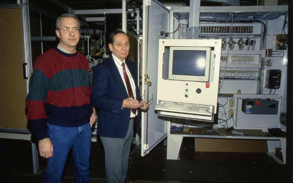 RJ file photo - Sal Barone and Tim Jennings are executives at Harper Surface Finishing Systems in Meriden, which makes industrial buffing and polishing machines, Jan. 13, 1994. Barone and other area executives are on a trade mission to Asia.