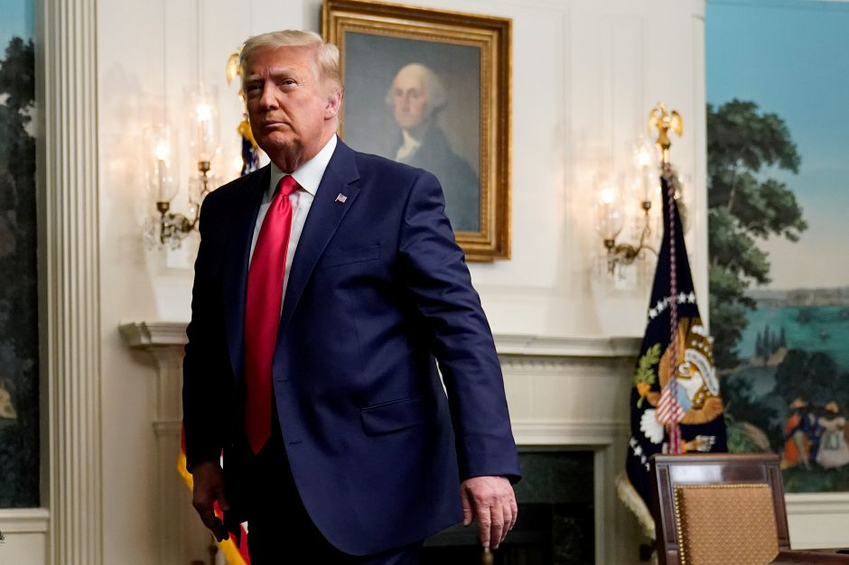 President Donald Trump departs after participating in a video teleconference call with members of the military on Thanksgiving, Thursday, Nov. 26, 2020, at the White House in Washington. (AP Photo/Patrick Semansky)