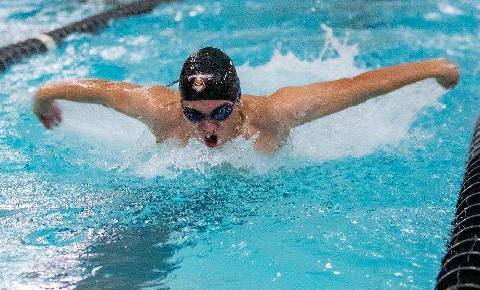 Sheehan's Aaron Gamble swims the butterfly leg of the 200 Medley Relay against Cheshire.