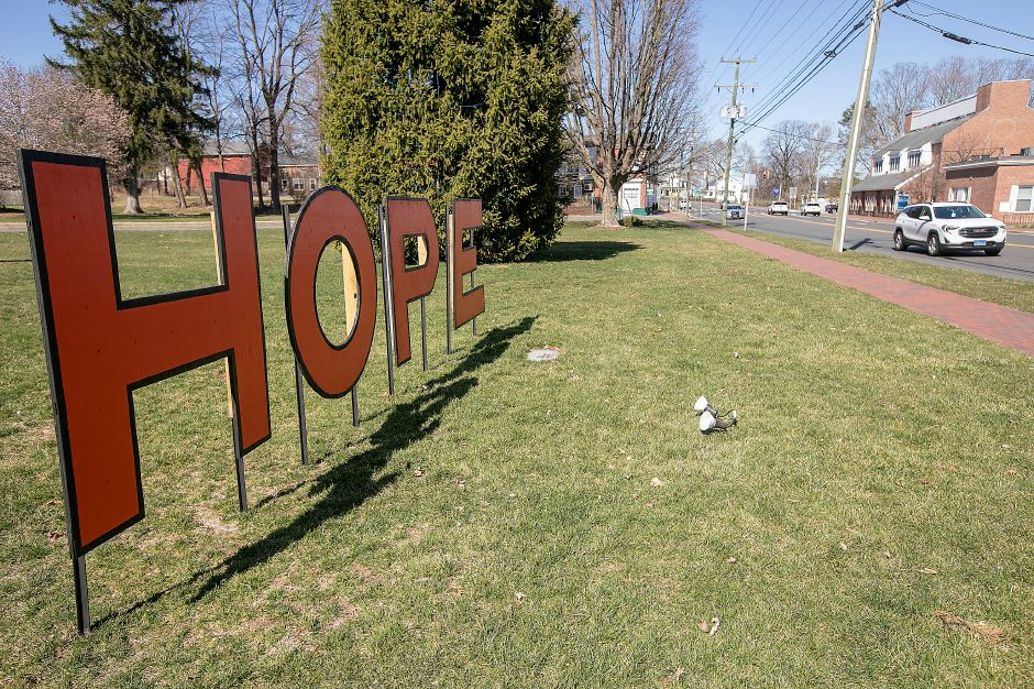 "A motorist traveling south on Route 10 passes a HOPE sign placed in front of the First Congregational Church, Fri., Mar. 27, 2020. In an effort to bring the community together, the Town of Cheshire, Cheshire Chamber of Commerce and Cheshire's Lights of Hope started a ""Nightly Bell Ringing."" Each night at 8 p.m., residents are asked to ring bells as a sign the community is united as it faces the threat of the pandemic. Dave Zajac, Record-Journal"