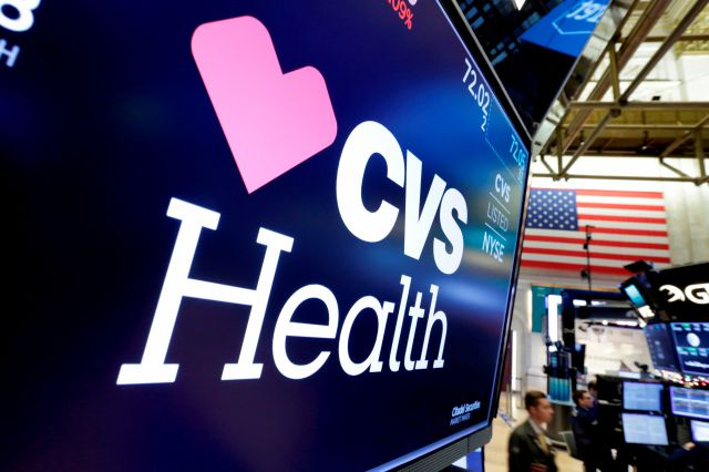 FILE- In this Dec. 4, 2017, file photo, the CVS Health logo appears above a trading post on the floor of the New York Stock Exchange. CVS Health reports earnings Wednesday, May 2, 2018. (AP Photo/Richard Drew, File)
