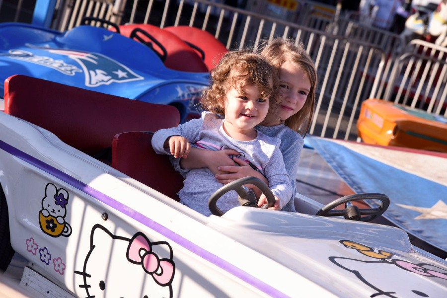 Rylee (left), 2, of Maine, rides a carnival ride with her cousin Morgan, 5, of Cheshire, at the Cheshire Fall Festival on Friday, Sept. 13, 2019. | Bailey Wright, Record-Journal