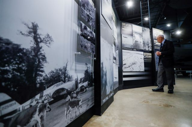 In this Friday, April 26, 2019 photo, a museum guide stops to view the D-Day displays at the The National Museum of the U.S. Air Force, in Dayton, Ohio. French-developed technology making its U.S. debut this month will allow new views of the D-Day invasion 75 years ago that began the liberation of France and helped end World War II. The National Museum of the U.S. Air Force near Dayton begins its D-Day commemorations May 13 with military-veteran paratroopers dropping from a vintage...
