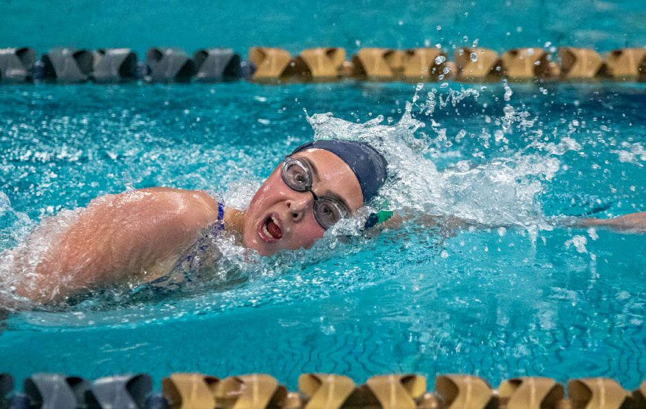 Avery Benigni won two individual events and swam on two first-place relays Wednesday at the Maloney pool to help the Meriden Co-op defeat Middletown for the first time ever. Aaron Flaum, Record-Journal
